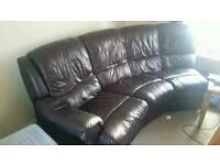Curved leather seater