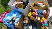 Various children's stuffed animals and toys