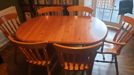 Lovely, solid, extendable dining table and 6 chairs.