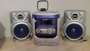 Multiple CD/cassette and radio sound system