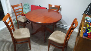 round hardwood table and 4 upholstered chairs