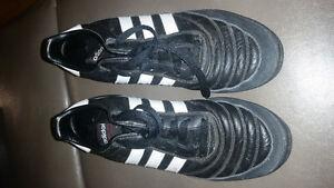 Adidas turf shoes.