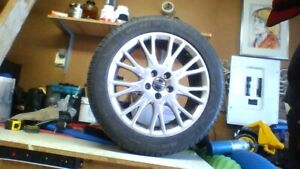 4 VOLVO RIMS AND MICHELIN X-ICE TIRES FOR SALE