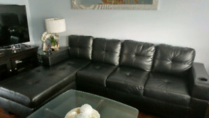 Black leather sofa with chaise