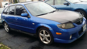 2003 Mazda Protege Hatchback need it gone open to offers