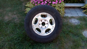 Original Chevrolet Silverado rims with tires