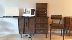 Sewing machine, including cabinet