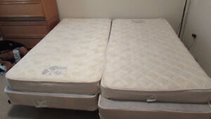 Two twin mattress with box springs
