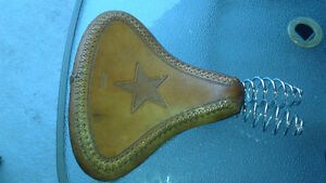 Genuine handmade brown leather motorcycle springer seat.
