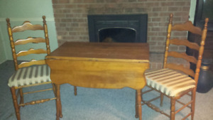 Solid maple drop leaf table. 4 ladder back chairs