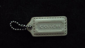Beige leather Coach tag & chain