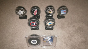 Collection Of Pucks In Protective Cases For Sale