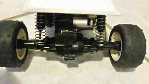 ACOMS racing car works good comes with remote and two batteries West Island Greater Montréal image 4