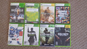 XBOX 360 console with controllers, charging cord and games