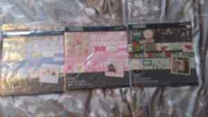 Baby boy, baby girl and family scrapbook sets.
