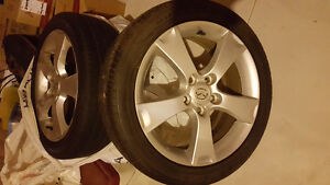 Mint condition 17 inch original Mazda rims and tires