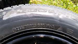 Five bolt pattern rims with winter tires.