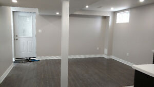 BEAUTIFUL, BRAND NEW BASEMENT APARTMENT $1,049 - ALL INCL