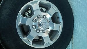 "For Sale: Polished Ram 18"" OEM wheels."