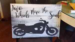Two wheels move the soul wood sign