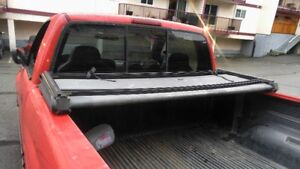USED TONNEAU COVER FOR FULL SIZE TRUCK WATER PROOF FOLDS UP