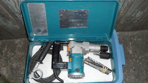 Makita HR2510 Hammer Drill $250. Comes with bit set and 2 chucks