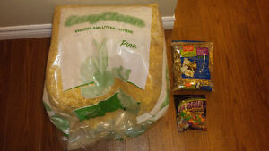 Bag of food, treats and pine bedding for small animals