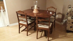 Antique dining table with extensions and 4 chairs and cabinet