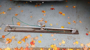 Adjustable height clothesline pulley