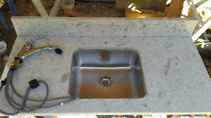Granite counter top with sink and tap