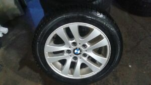 """16"""" aluminum BMW wheels with tires"""