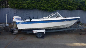 Sangster boat with 70 hp Evinrude