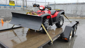 Honda ATV 4X4 equipped with WARN snow plow