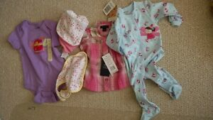 $15 for 4 brand new baby clothes size 6-9 montha