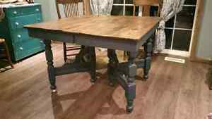 Beautiful very antique Table with castor wheels.