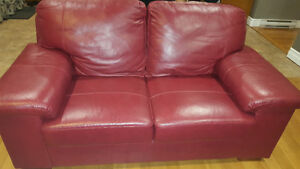 Red leather couch and love seat