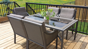 Patio table with glass top and 5 chairs