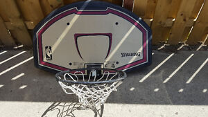 Spalding basketball hoop, backboard, and bracket