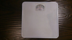 White Bathroom Scale in good working condition. $5.00
