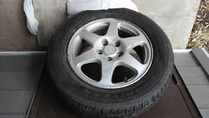 Four Good Year summer tires on rims for a 2008 Hyundai Sonota.