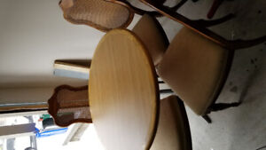 Solid wood Dinning table 4 Chairs in excellent  condition.