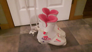 Woman's ski boots and matching poles