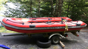12.5 foot inflatable boat, very good condition, no trailer.