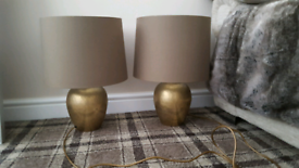 Large pair of antique hammered brass lamps BHS