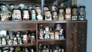 Selling toby mugs paper weights furniture primitives toys etc,