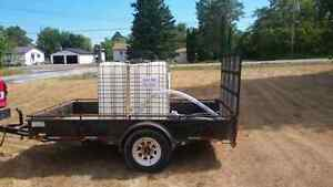 """Trailer and water tank and  2"""" gas  Pump  for rent"""