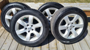 215 60 16 inch Winter Tires with Rims. From Nissan Altima