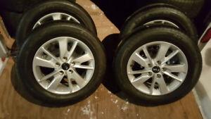 4 Mag KIA neuf  avec pneu d'ete NEXEN 205 65R 16 tout .Neuf