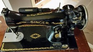 REDUCED***ANTIQUE SINGER SEWING MACHINE AND CABINET
