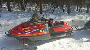 Three snowmobiles for sale